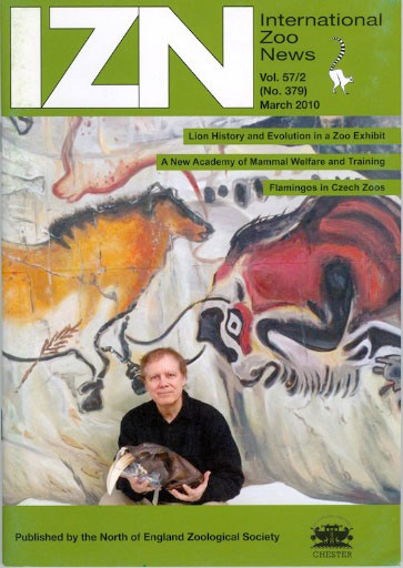 Cover of International Zoo News (2010) with Robert posing in front of his Cave Lion Exhibit. He is holding a replica skull of a Sabertooth Cat, which was part of an associated exhibit on prehistoric predators with massive canines. (photo by Darlene Stack)