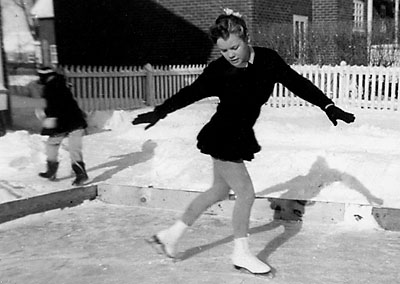 Jean Wrigley practising figures on a back-yard rink (c. 1956).  Jean later won the Eastern Canadian Figure Skating Championship and then turning professional, she pursued a career as a soloist with the Ice Follies.