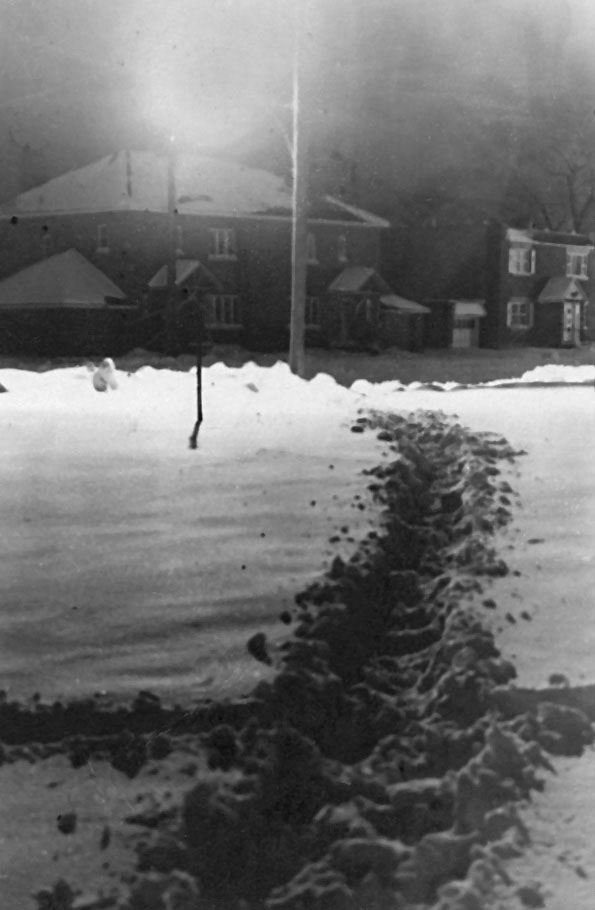 Picture is a time exposure, taken of the path that cut across an open field between Merton and Curzon.  Shot in 1948. The houses in the background are on Desaulnier(s?) Blvd.